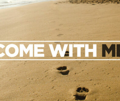 come with me text on sand with footprints